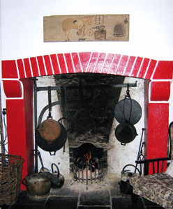 hearth with cast iron cooking utensils